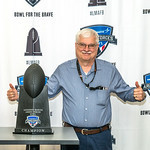 Lockheed Martin Armed Forces Bowl Trophy with employees